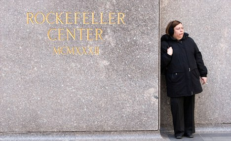 Last days: Woman enjoys a cigarette at the Rockefeller Center while she still can as from May 23 smoking in public places will be banned