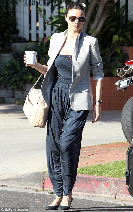 Looking trim: Australian model Miranda Kerr showed off her slim figure in a navy jumpsuit and grey blazer