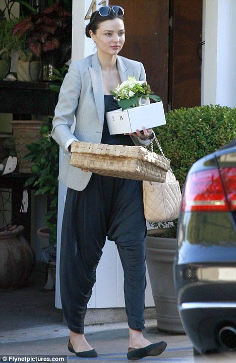 I'll take the car: With a baby in tow, and a growing pile of shopping, Miranda wisely decided to take their Audi A8 home