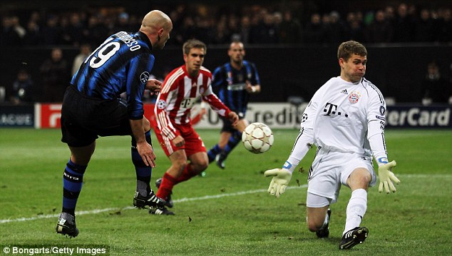 Big moment: Kraft makes an excellent block to keep out Cambiasso's drive