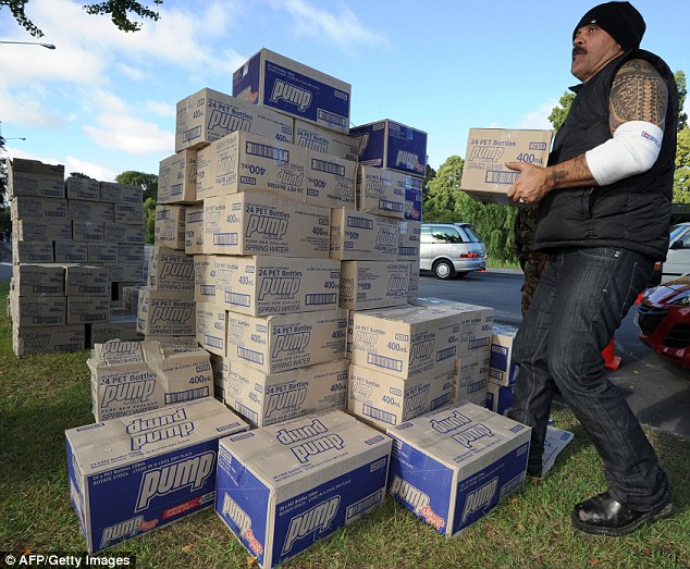 Vital supplies: A man collects drinking water from a distribution point in Christchurch