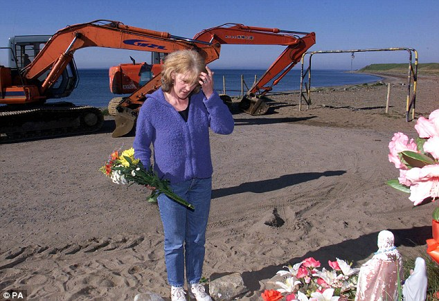 Grim task: Helen McKendry pictured on a beach in County Louth in 2000 during a police search for her missing mother