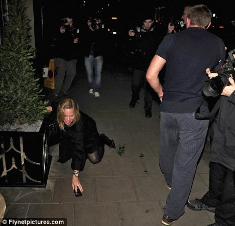 Bad boy: As the woman scrambled for her phone Ritchie looked away and carried on walking