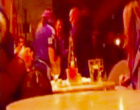 A still from an amateur video that captured fashion designer John Galliano, centre left, during an alleged encounter at a Paris cafe that led to his arrest