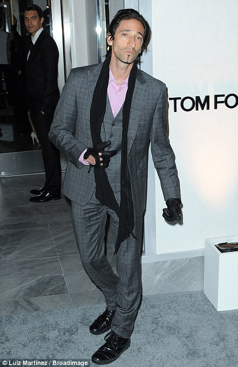 Very smart: The actor looked dapper in a grey suit and pink shirt as he attended the Tom Ford store opening in Beverly Hills earlier in the night