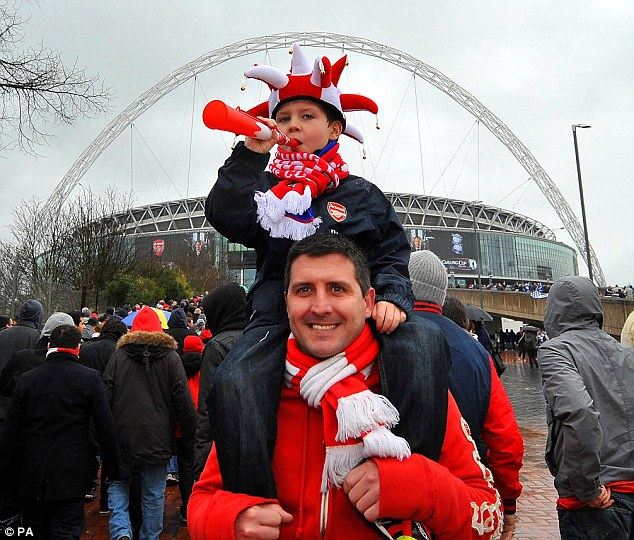 Top Gunner: Arsenal fans on the walk up to Wembley Stadium, while below two Birmingham fans show their support
