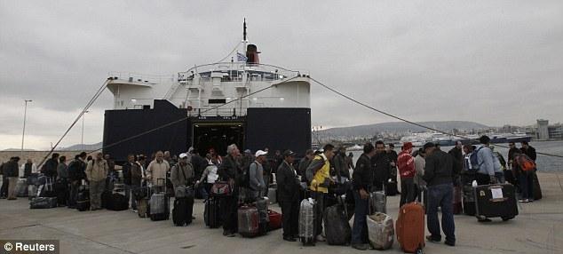 Dangerous: Evacuees disembark at the port of Piraeus, Athens