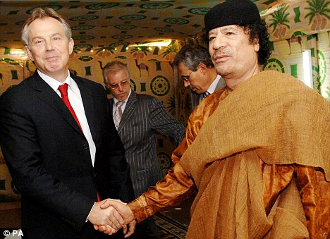 Sealing the deal: Mr Cameron was absolutely right yesterday to condemn as 'appalling' the deals made by the Labour government with Gaddafi