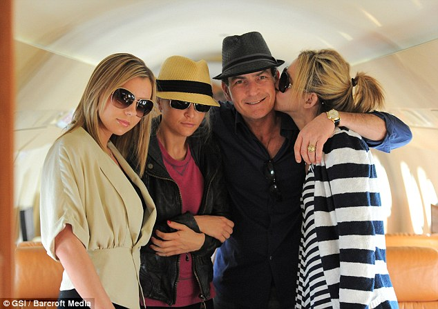 Menage a quatre: Sheen's ex Mueller, pictured second left, joined him on his trip tot he Bahamas with his girlfriends Bree Olson (l) and Natalie Kenly (r) - but soon fled