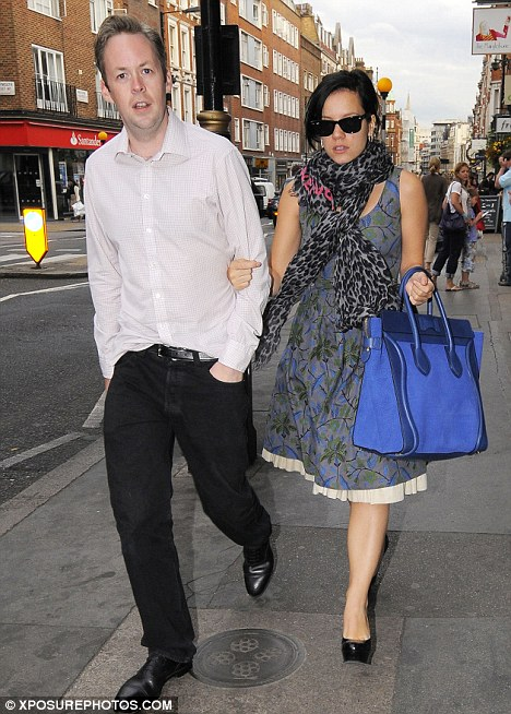 Betrothed: Lily and her fiancé Sam Cooper, seen here in London last summer