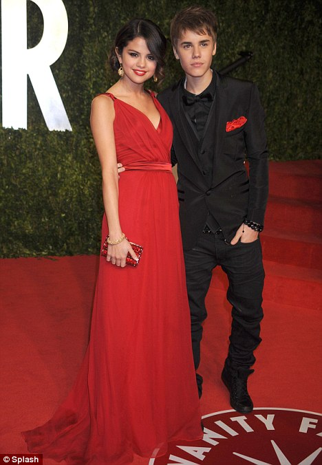 Going public: Justin and Selena made their public debut in style at the post-Oscars Vanity Fair party this week