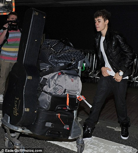 On tour: The Never Say Never star arrived today in England, where he will kick off the European leg of his world tour in Birmingham tomorrow night