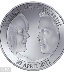 Royal Mint handout of the official £5 coin commemorating  Prince William and Kate Middleton's wedding