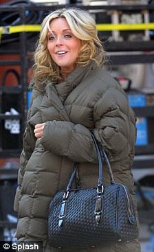 Bump watch: Pregnant Jane Krakowski keeps her growing baby bump under wraps on the set of 30 Rock