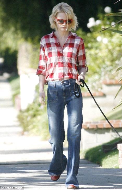 Shrinking: A slimmer January Jones walking her dog in LA