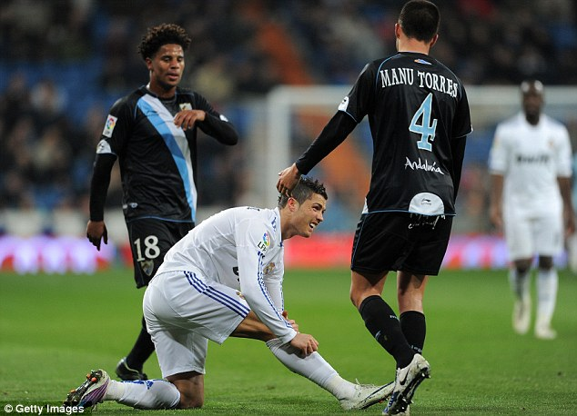 Cause for concern: Portuguese star Ronaldo worried Real Madrid when he was forced off against Malaga