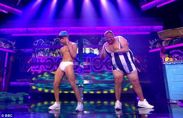 Tight fit: Lee Nelson, aka comedian Simon Brodkin, and his comedy sidekick Omelette, danced to Club Tropicana by Wham! in just their swimwear