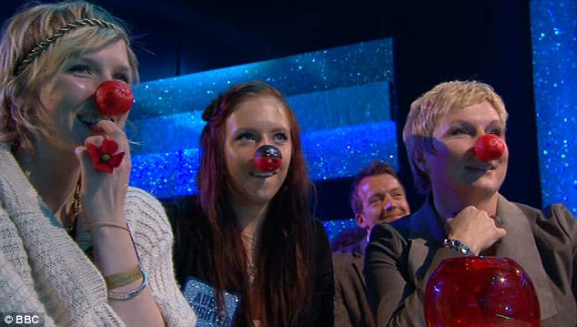 Family fun: Ade was cheered on by wife Jennifer Saunders, right, and two of their three daughters