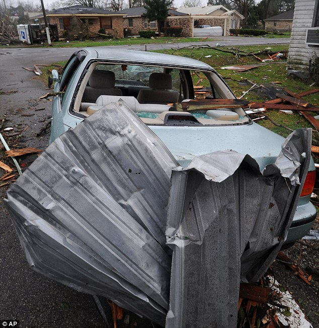 Damage: The tornado hit the town yesterday and left a three-mile-long trail of destruction