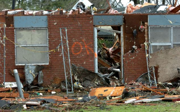 Devastation: Police said the storm had torn some houses from their foundations and caused gas leaks