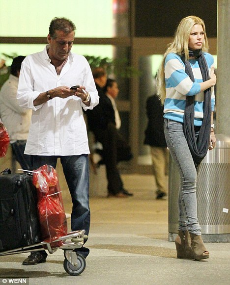 Over: Sophie Monk and Jimmy Esebag pictured a month ago on their return to Los Angeles after a romantic break