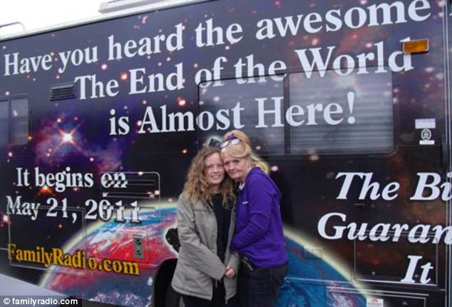 Message: Ambassador Sheila Jonas (right) stands in front of her caravan emblazoned with the end of the world message
