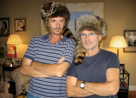 One fur the album: Phil Collins (right) sporting an Alamo fur hat. He is a self-confessed battle of the Alamo anorak