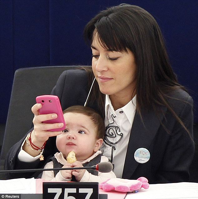 You've got an important email Mum: The baby looks concerned at the latest message on her mother's Blackberry