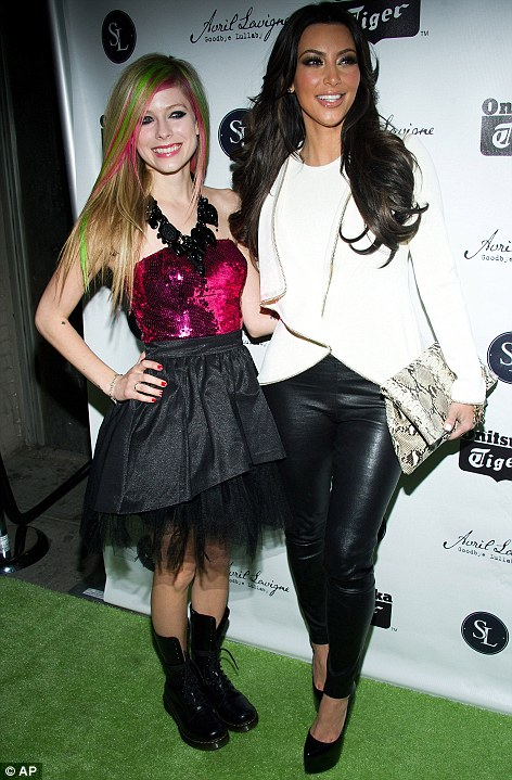 Little misses: Kim Kardashian joins Avril Lavigne at the launch party for her new album Goodbye Lullaby in New York