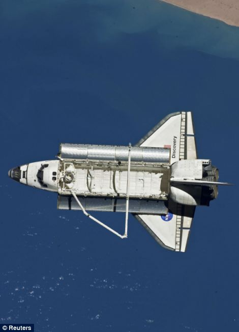 The space shuttle Discovery is seen from the International Space Station after the undocking of the two spacecraft
