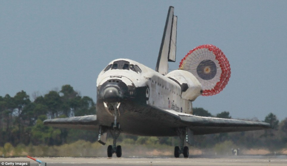 Grounded: Nasa's oldest shuttle swooped through a mostly clear sky to land at its home base and end its 39th mission