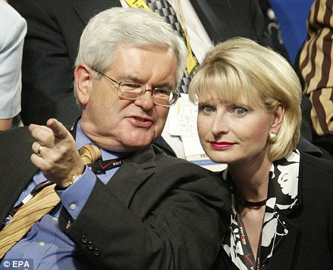 Newt Gingrich the former House speaker talks to his wife at  the Republican National Convention in Madison Square Garden, New York, Thursday 02 September 2004. U.S.