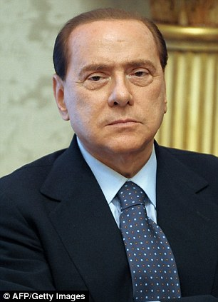 Italy's Prime Minister Silvio Berlusconi looks on during a meeting with Kuwait's Sheikh Nasser al-Mohammed al-Sabah