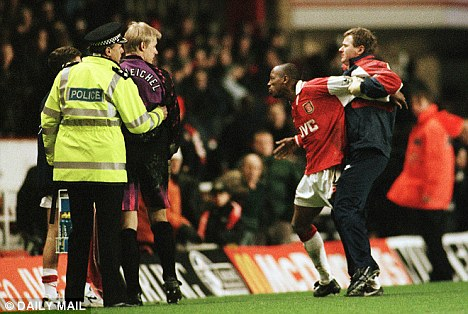 Best of enemies: Ian Wright and Peter Schmeichel had to be separated after an ugly clash in February 1997 at Highbury