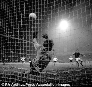 Stoke City goalkeeper Gordon Banks saves a penalty from West Ham United's Geoff Hurst (r)