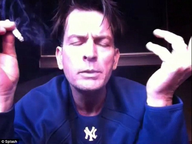 Troubled: Sheen seen here smoking and looking deranged in one of his UStream internet broadcasts this week