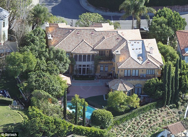 Luxurious: Sheen's sprawling mansion is located in a gated community in Beverly Hills