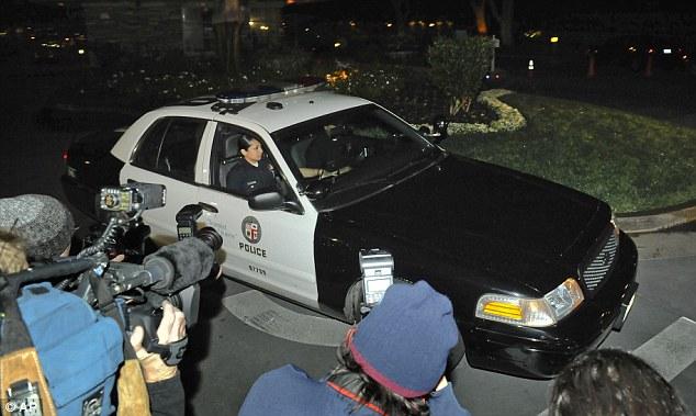 Raid: Los Angeles police outside the home