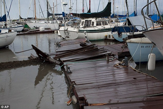 Damage: Piers and moorings in Hawaii's ports suffered as they were hit by tsunami waves after the Japanese earthquake