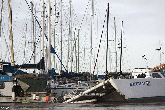The morning after: Boats in Keehi Small Boat harbour, Honolulu, were severely damaged by the tsunami waves which struck the coast in the early hours