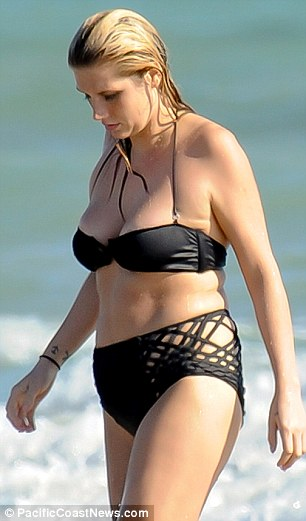 Not very flattering: Kesha's bikini bottoms featured strange detailing on either side