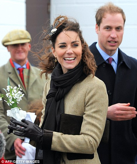 Prince William and his fiancee Kate Middleton  arrive for a naming ceremony for the new Royal National Lifeboat Institution's