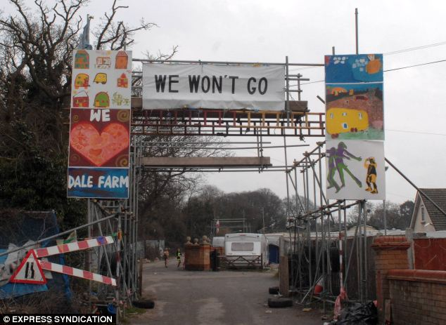 Defiant: The traveller community at Dale Farm in Crays Hill, Essex say they will refuse to leave without a fight