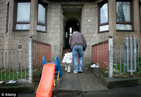 a child and her father on a poverty stricken estate in Maryhill Glasgow