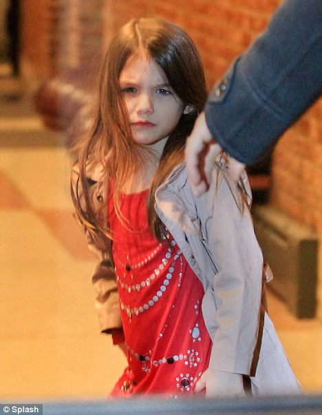 Daddy's girl: Suri looks the image of her action man father Tom Cruise