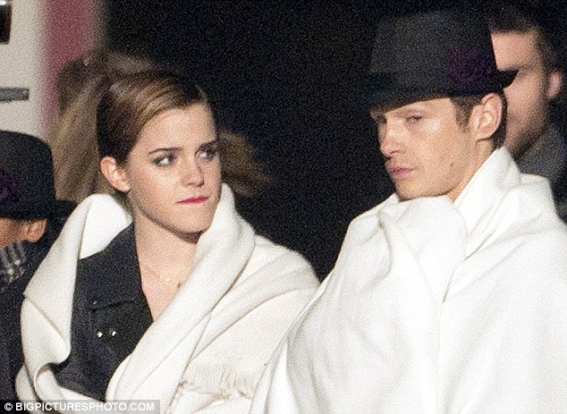 Chilly work: Emma and Cyril wrapped up warm in blankets in between takes on the freezing night shoot