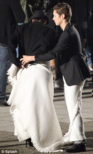 What a gentleman: Cyril rushes over to Emma with a blanket as she begins to feel the cold on her bare legs