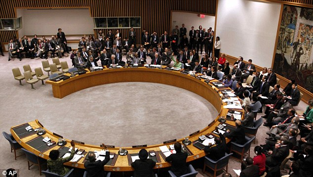 In session: Member states including both the UK and U.S. vote to approve the resolution during the meeting of the Security Council last night