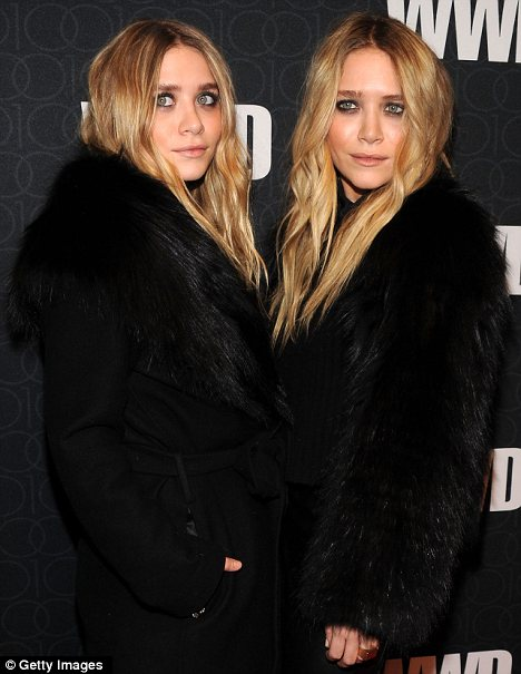 Thrilled: Ashley and Mary-Kate Olsen admitted in an interview last year that they would love to see Mrs Obama wear their designs