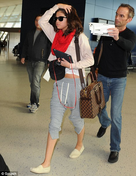 Victim: Selena Gomez seen at JFK airport in New York today, she is believed to be among 50 celebrity targets of a hacking team